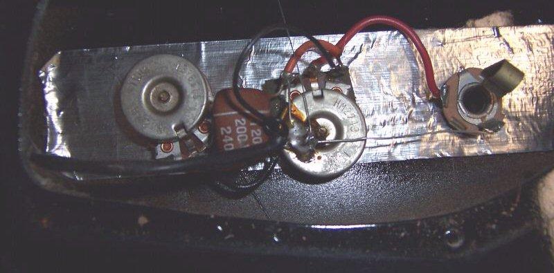 a 1-pickup danelectro tone-filter capacitor  notice the 100k tone pot!: